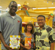 Children's authors Seth Fowler, left, and Alva Sachs with their books and store manager Erick Lina.